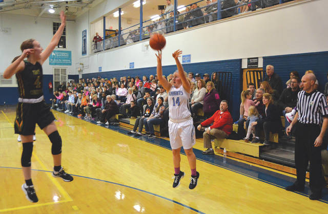 Legacy Christian junior guard Margaret Kensinger (14) hits a 3-pointer in the first half against previously unbeaten Troy Christian, Jan. 30, in Xenia.