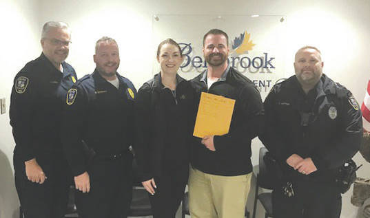 Submitted photo Bellbrook Police officers participated in No Shave November and donated $550 contributions and other donations to the Maple Tree Cancer Alliance in memory of BPD Sgt Brian Meade. Pictured are Chief Doherty, Lt. Carmin and Det. Vetter presenting the donation to Dani and Rob of Mapletree Alliance.