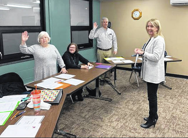 Photo courtesy Cedar Cliff Local Schools Treasurer Joy Kitzmiller completes the swearing-in ceremony for Charlene Campbell and Matt Sheridan during the Cedar Cliff Local Schools Board of Education organizational meeting.