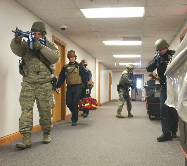 Submitted photo Active shooter response is the focus of a base-wide exercise Wednesday. Wright-Patterson Air Force Base defenders and emergency response personnel enter a base facility during a February 2015 active-shooter exercise.
