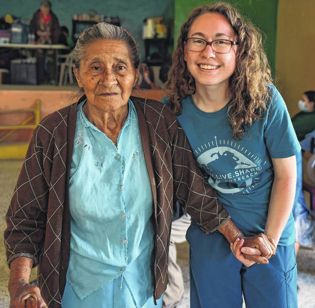 Submitted photo A Cedarville University student with Honduran woman during a previous trip.