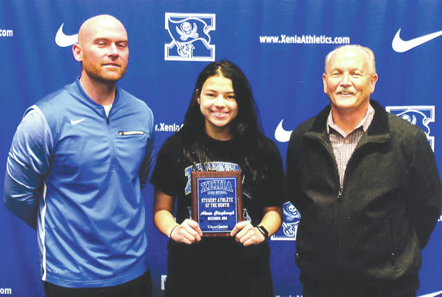 Alexis Claybaugh (center) was chosen as the Edward Jones Investments Athlete of the Month for December for Xenia High School. This award is being sponsored by Mike Reed (right) at Edward Jones Investments of Xenia, serving Xenia, Jamestown, Cedarville and surrounding areas. Claybaugh, a senior on the girl's basketball team, is a two-sport athlete. She also plays soccer and is the definition of a student athlete. She carries a 3.95 grade-point average and was recently accepted to The Ohio State University where she plans to study nursing.