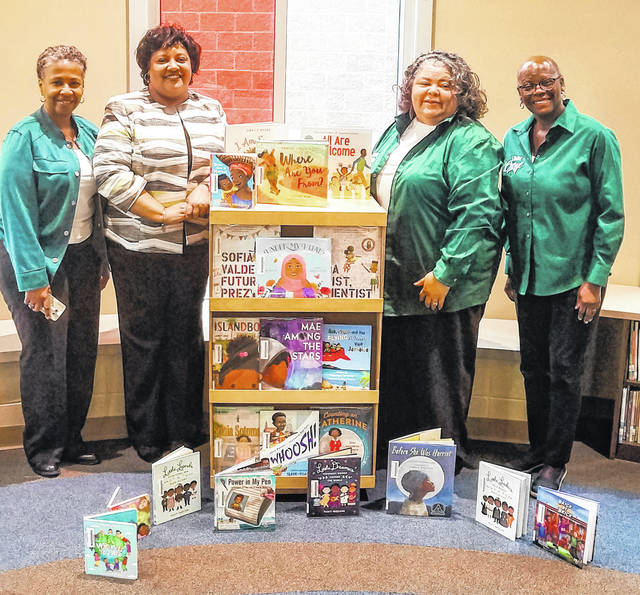 Photos courtesy Xenia Community Schools The Wilberforce Chapter of Links, Inc., recently donated 21 books to the Cox Elementary School library. Pictured around the books are Links members Angela Williams, Lisa Peterson (also Cox principal), Atreva Vaughan, and Cheryl Marcus, also a Xenia school board member.