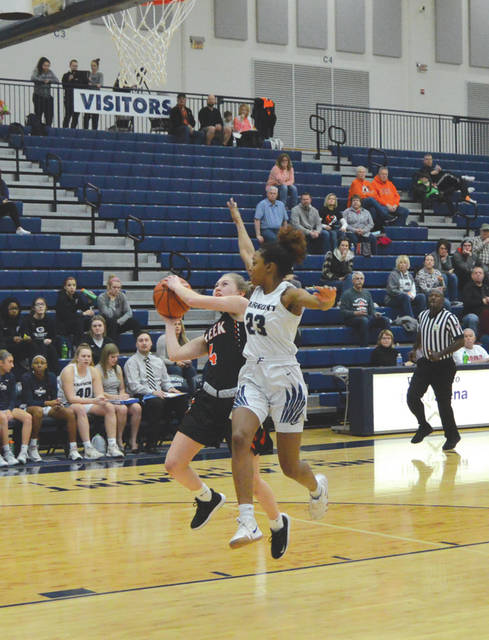 Ashley Vaughn (4) of Beavercreek has her shot challenged by Fairmont senior Makira Webster (23), during Saturday's Greater Western Ohio Conference girls high school basketball game at Trent Arena, in Kettering.