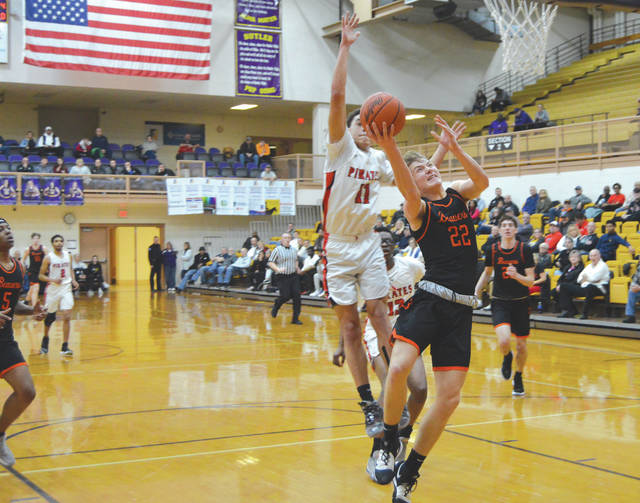 Beavercreek sophomore forward Adam Duvall (22) is fouled on this first-half scoring attempt. In the second half with the game on the line, Duvall hit a pair of free throws to earn the Beavers a come-from-behind win, Feb. 26 at the Butler High School Student Activities Center in Vandalia.