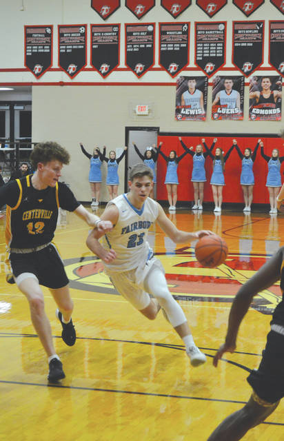 Fairborn's Cole Spencer (23) scored all five of the Skyhawks' points in the opening quarter against top-seeded Centerville, Feb. 25 at Tecumseh High School's Reynolds Gymnasium in New Carlisle.