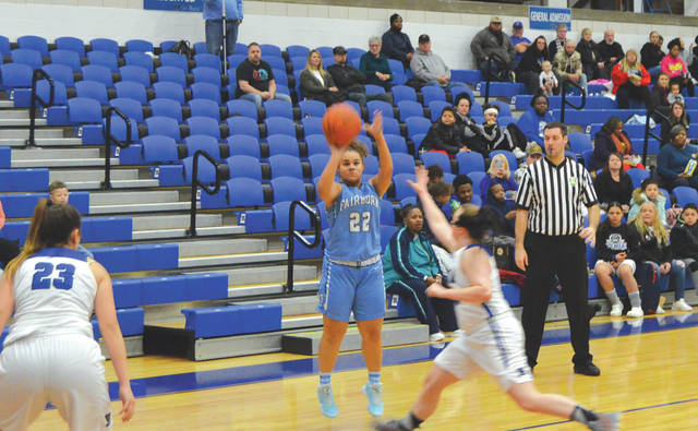 Fairborn junior guard Jodee Austin (22) puts up a three-point shot, during the first half of Saturday's Miami Valley League girls high school basketball game at Xenia High.