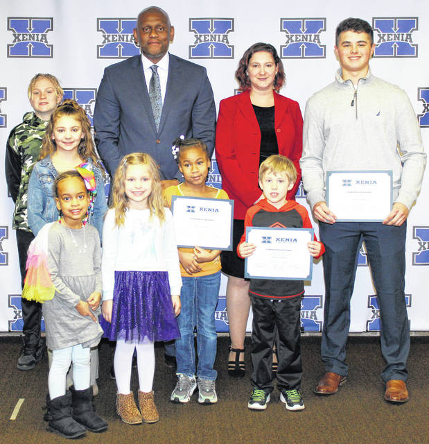 Photo courtesy Xenia Community Schools The Xenia board of education recognized its kids of character earlier this week. Pictured with Superintendent Dr. Gabe Lofton and board President Jennifer Marietta are Harper Grooms (preschool), Olivia Odje (Arrowood), Miracle Kalebaba (Cox), Porter Blackaby (McKinley), Cami Loeliger (Tecumseh), Otis Boyette (Warner), and Kyle Lane (high school). Not pictured is Micah Bennett (Shawnee).