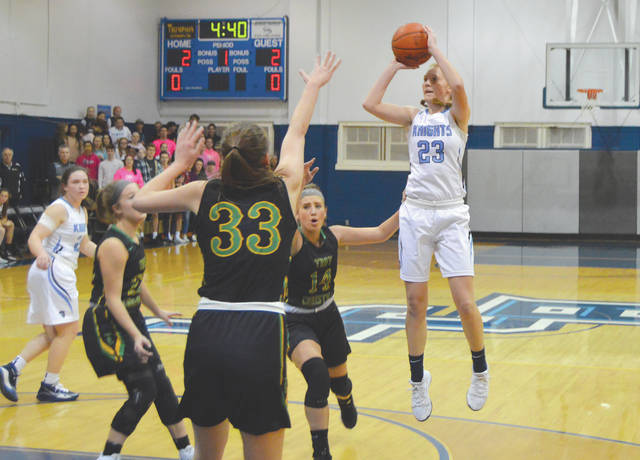 Emma Hess, shown in action against Troy Christian earlier this season, scored a game-high 28 points in a 69-40 win over Felicity-Franklin in a sectional final Monday at Monroe High School.