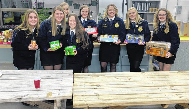 Photo courtesy Greeneview High School Greeneview students Kelsey Stone, Claire Morris, Taylor Linebaugh, Ana Clark, Makayla Kilbarger, Tori Chaney, Frankie Travis, and Leslie Gardner display canned goods.