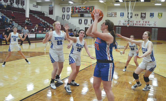 Carroll senior Julia Keller (42) puts the finishing touches on a 27-0 scoring run to start Tuesday's Division II sectional quarterfinal game with Brookville, Feb. 18 at Lebanon High School.