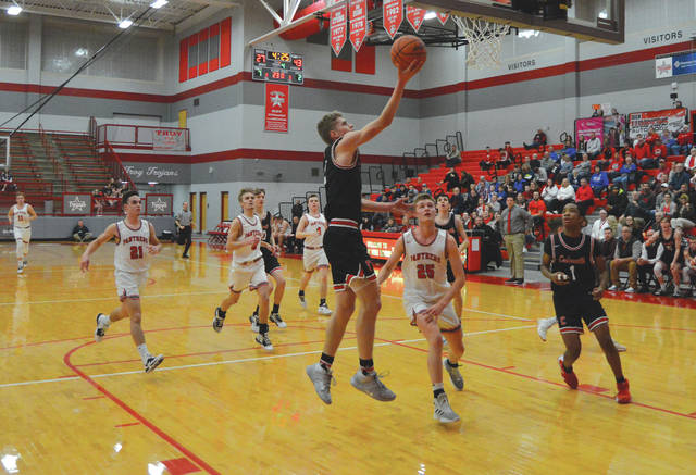 Junior Trent Koning soars in for a breakaway layup, during the second half of Thursday's Feb. 27 Division IV sectional semifinal game against Twin Valley South, at Troy High School.