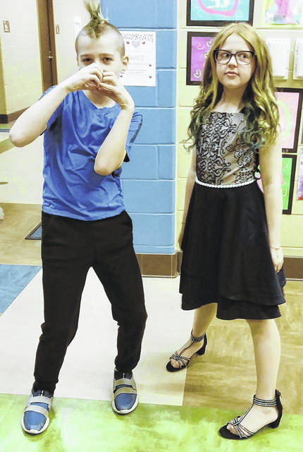 Submitted photo Leap Year-born Brody Stanfill (left), and his 10-year-old sister, Alaina, ham it up before a recent school dance.