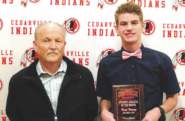 Trent Koning (right), shown with Mike Reed of Edward Jones Investments, was chosen as the Edward Jones Investments Athlete of the Month for December 2019 for Cedarville High School. This award is being sponsored by the office of Mike Reed at Edward Jones Investments of Xenia, serving Xenia, Jamestown, Cedarville and surrounding areas. Koning, a junior on the varsity basketball team, is averaging 16.3 points, four rebounds, 3.2 steels, two assists, has a field goal percentage of 51.5, three-point percentage of 42.9, and free-throw percentage of 87.1. He also has an impressive 4.0 grade-point average.