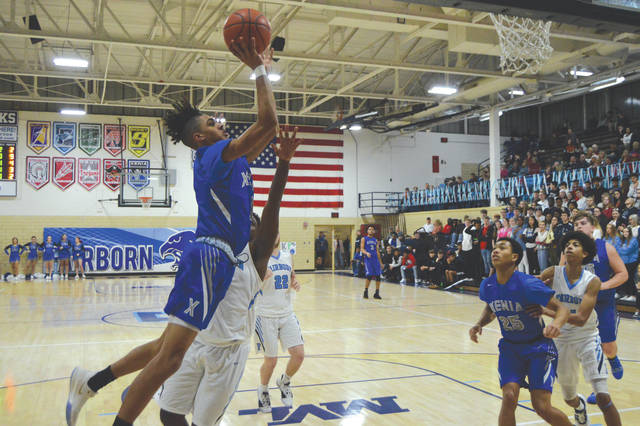 Freshman guard Shawn Thigpen of Xenia puts up a shot from the right baseline in the first half of Friday's Feb. 14 boys high school basketball game between Xenia and host Fairborn, at Baker Memorial Gymnasium.