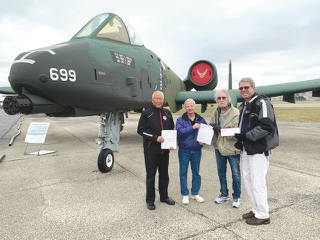 "Submitted photo Presentation with RBR officials and donation in front of USAF A-10 ""Tank Killer."""