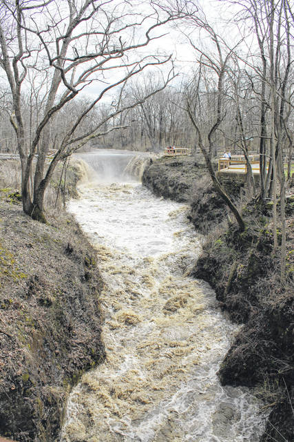 Two families check out Cedar Falls March 20 after heavy rains fell the night before.