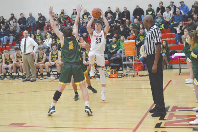 Cedarville High School senior Colby Cross (23) puts up a shot in a game this season. Cross was selected to the Division IV All-Ohio second team earlier this week by a statewide media panel.