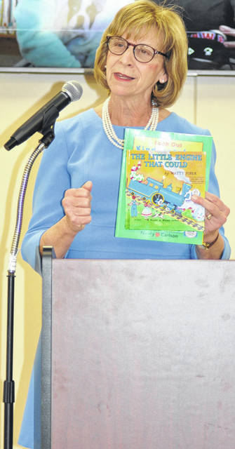 Scott Halasz | Greene County News First Lady and Greene County resident Fran DeWine shows some of the books children can receive free through the Ohio Governor's Imagination Library.
