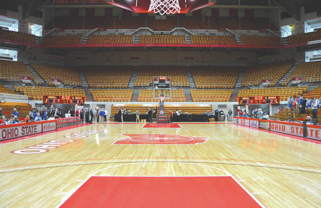 Ohio State University's St. John Arena stands nearly empty moments after Thursday's Division II girls high school state semifinals basketball game was suspended indefinitely in an effort to slow down the spread of the coronavirus.