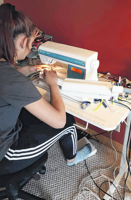 Submitted photos Isabell Carrington, 14, sews a homemade face mask.