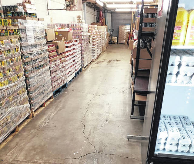 Photo courtesy Xenia Area Fish Food Pantry The Xenia Church of Christ and other volunteers deep cleaned the pantry on Friday. The pantry is no longer open for face-to-face visits, but is giving out food by appointment.