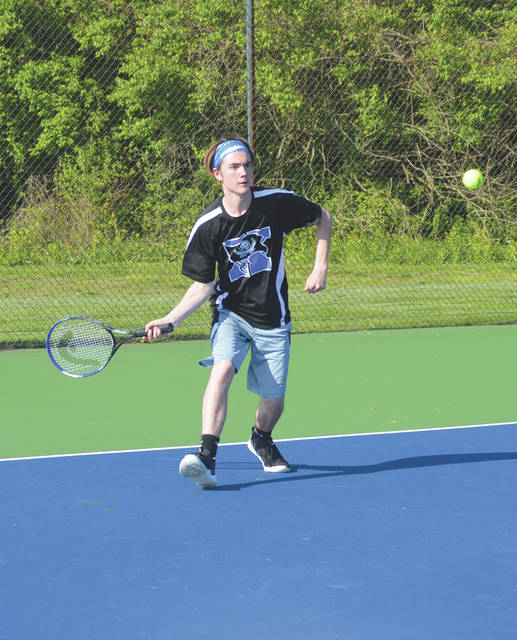 Xenia's Alex Robinson hits a baseline forehand in a boys high school tennis match last season.