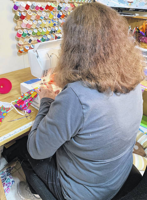 A local resident works on sewing masks.