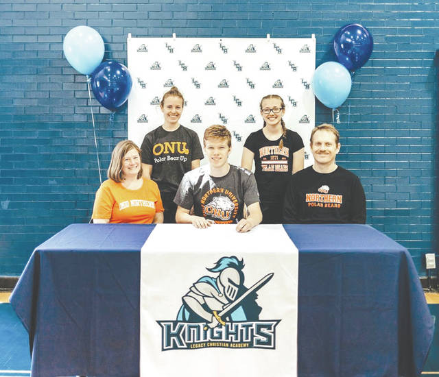 Legacy Christian senior Ian Ackenhausen (center) has signed a National Letter of Intent to attend Ohio Northern University and compete on the men's track and cross country teams.