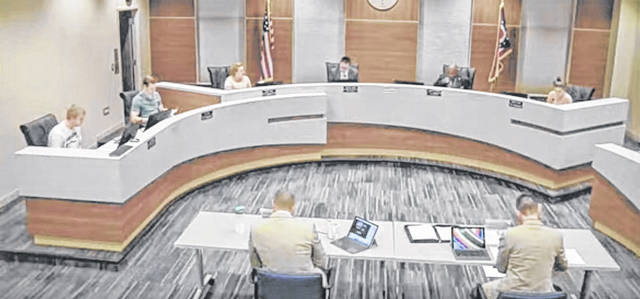 A screen shot of the Xenia City Council meeting from last week showed the extra precautions taken by members to make sure they are socially distant. City Manager Brent Merriman and Finance Director Ryan Duke sat six feet apart at a table away from the council members. Normally all seven council members, Law Director Donette Fisher and Merriman and Duke sit where the council is sitting now. There is an extra seat between each council member.