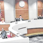 Council meets but members keep their distance