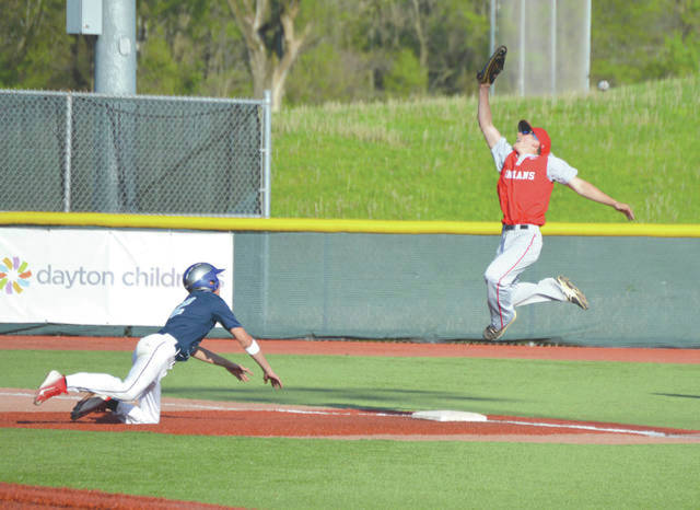 Legacy's Deuce Brown dives back to second base on a pickoff throw two seasons ago.