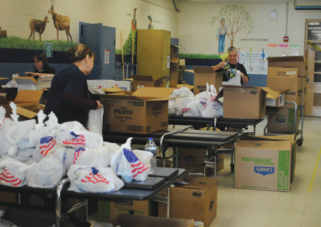 Whitney Vickers | Greene County News Child nutrition staff at Fairborn City Schools work to ensure students remain fed during the school closures in response to the COVID-19 pandemic.