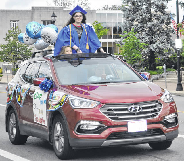 Scott Halasz | Greene County News Xenia High School's seniors didn't get to take part in many traditional graduation activities, but they did get a parade through town and recognition in a virtual commencement.