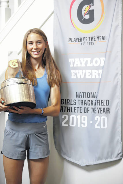Photo courtesy Gatorade Beavercreek's Taylor Ewert holds the Gatorade Girls National Track and Field Athlete of the Year trophy. She received the award in a surprise ceremony at her home Tuesday.