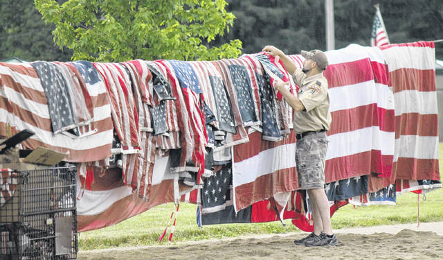 Anna Bolton | Greene County News About 1,200 old flags were respectfully retired on Flag Day, June 14, at the Greene County Fairgrounds. A large crowd of community members showed up to watch the patriotic event in its fifth year. The ceremony is a way to properly retire and dispose old, worn, tattered or soiled flags. Residents dropped off their flags prior to the event and also brought them to the fairgrounds that day. For more photos, check inside today's paper.