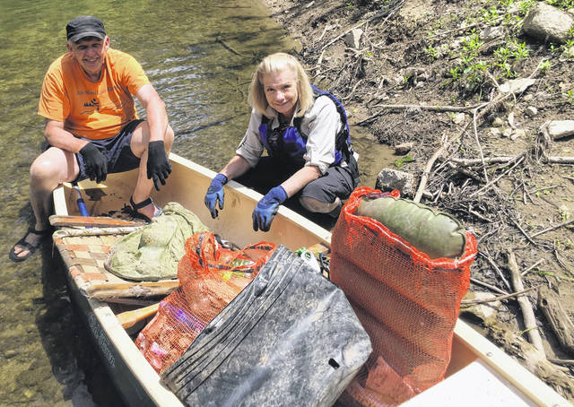 Bill Blessing and Andrea Stewart filled a canoe with trash.