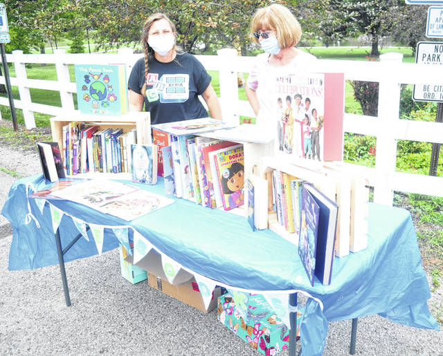 Photos by Scott Halasz | Greene County News Jo Chamberlain (left) and Kay Gerspacher display the books they are offering to Xenia families for free this summer. Their goal is to make sure kids keep reading even though they aren't in school.