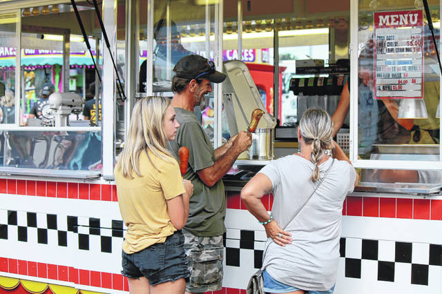 File photo Fair-goers order corn dogs at the 2019 Greene County Fair.