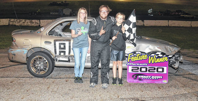 Tyler Mahaffey of Beavercreek won the 100 lap enduro feature. Shown in the picture with Mahaffey is his mother, Cheri, and brother, Dallas.