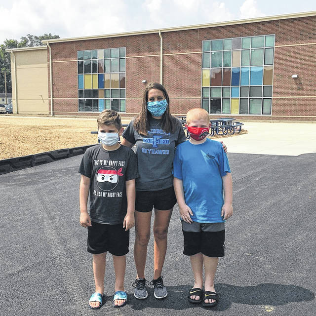 Myles and Mason Gilliam stand with 2nd grade teacher Ms. Engle.