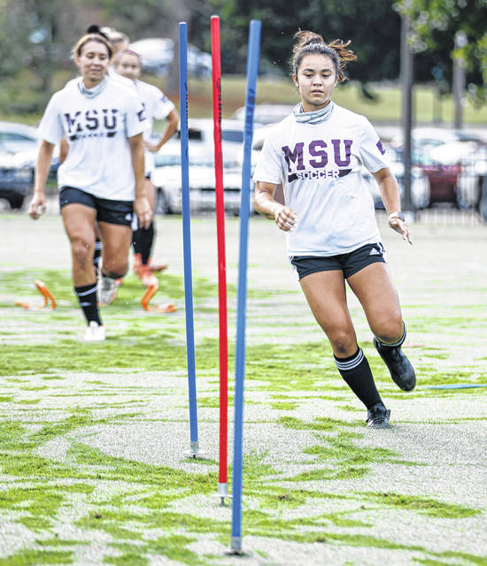 Photos courtesy Mississippi State Athletics Mississippi State Forward Marcella Cash participates in drills during practice in August. The Beavercreek grad earned her first collegiate start after solid minutes in the season opener against Auburn.