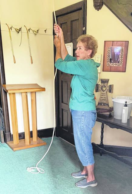 Submitted photo Cedar Cliff DAR member Cindy Spracklen rings the bell at Cedarville Presbyterian Church 33 times on Sept. 17, Constitution Day, to celebrate the signing of the document 233 years ago.