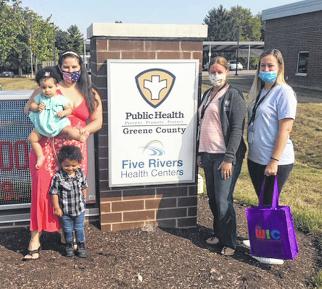 Submitted photos Athena Brown of Fairborn with her children, Adara (1) and Julius (2) stand with Greene County Public Health Breastfeeding Peer Helpers Elizabeth Varvel and Jamee Wellman.