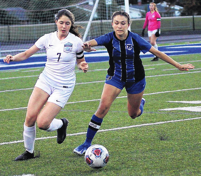 Photos by Barb Slone | Greene County News Fairborn's Lauren Murry and Xenia's Chloe Castonguay race to the ball during first-half action Monday.