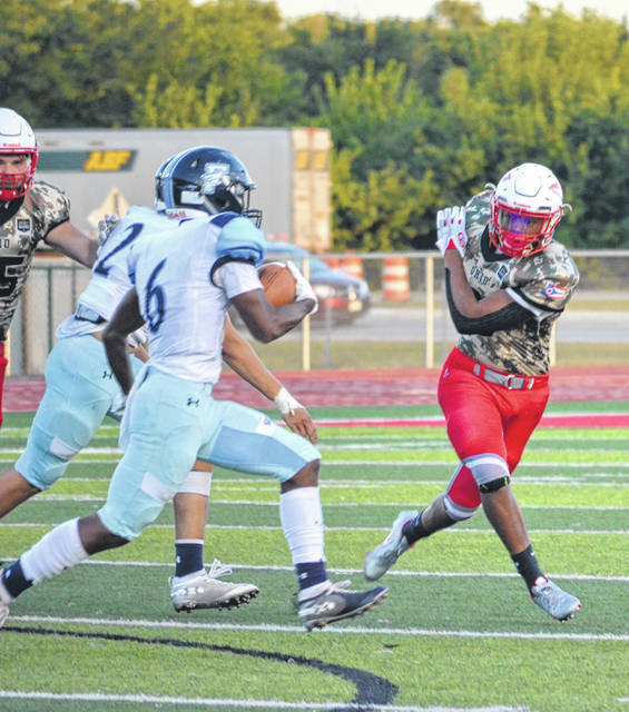 Fairborn's Brody Munger sprints past the Stebbins defensive line.