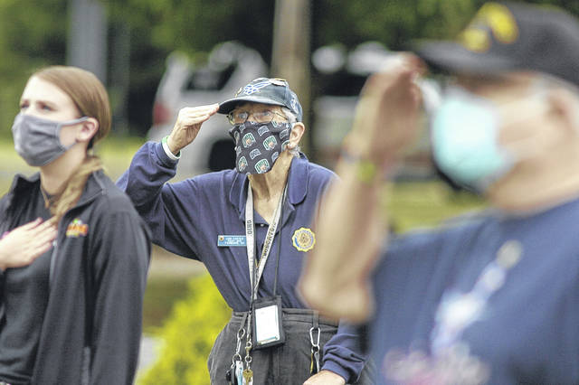 Ann Foster, an Air Force veteran, salutes Friday, Sept. 11 at the National Center for Medical Readiness, known as Calamityville, on East Xenia Drive. Fairborn held the remembrance ceremony for those lost in the 2001 terrorist attacks 19 years ago. For more photos, see inside today's paper.