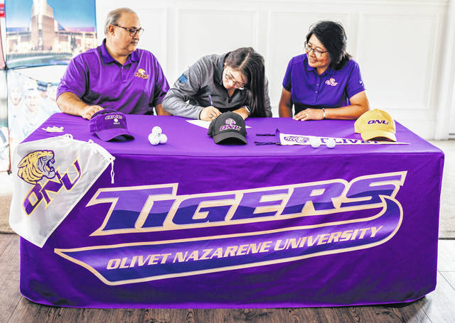 Photos courtesy Legacy Christian Academy Legacy senior Liz Miller signs to golf at Olivet Nazarene University in Illinois, while her parents, Steve and Michelle, look on.