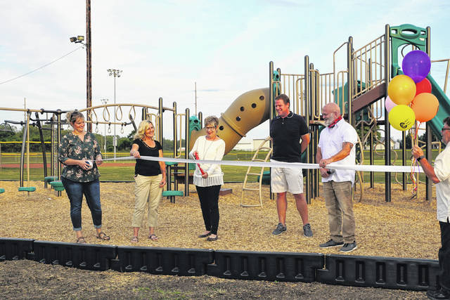 Photos by Barb Slone | Greene County News Cedarville Community Park committee members unveil the village park's new look Sept. 6. Updates include new playground equipment, landscaping, and fencing and bridges. The village received $59,000 in 2019 Community Development Block Grant funding through the Greene County Department of Development for the new equipment. Other donors contributed to the project as well. Pictured at the ribbon cutting are committee members Katie Blocher, Cheryl Hudgell, Jackie Pyles and Andrew Wonders with Cedarville Mayor Tony Pergram. Not pictured are committee members Grace Becknell and Nick Dudukovich and Department of Development Community Development Coordinator Sarah Mault. Others involved in the project were Greene County Parks and Trails, village administrators, Dean's Landscaping, Cedarville Township trustees, and mowers Larry Sparks and Gary Furay.