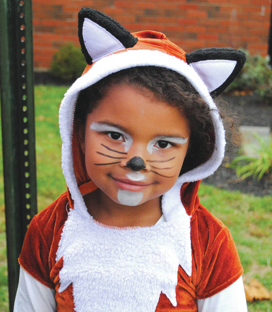 File photo Children dressed up for Fairborn Primary School's trunk-or-treat event in 2019.